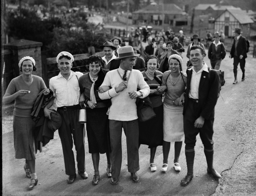 Photo of a group of men and women walking together