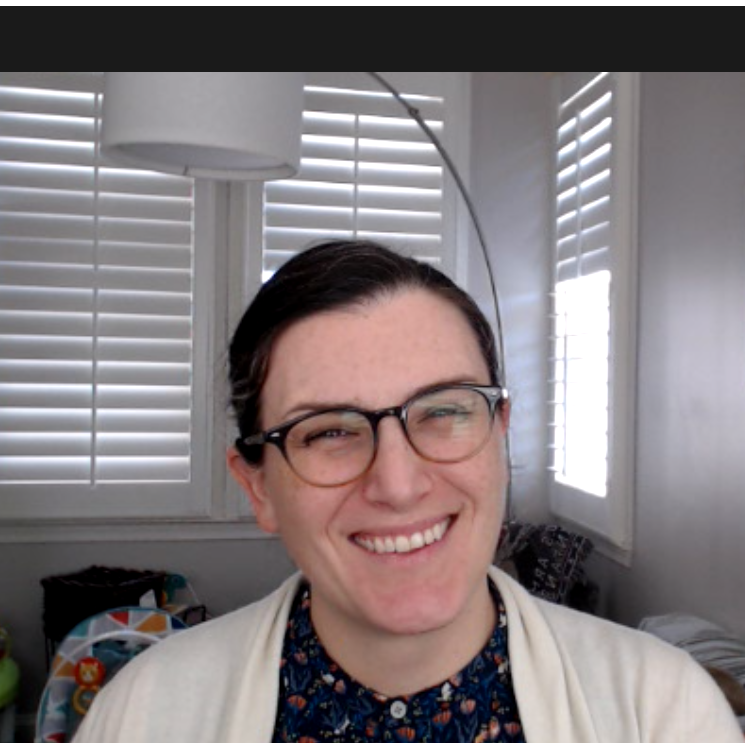 woman smiling in video conference window